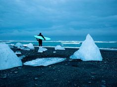 On Iceland's west coast, surfer and photographer Chris Burkard captured surfer Keith Malloy heading toward the river mouth of Vatnajokull glacier.