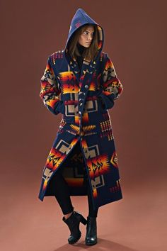 Reversible Long Coat, Chief Joseph, Indigo Designed exclusively by Kraff's this reversible, long coat is aSouthwestern inspired design. Made by Kraff's using a genuine Pendleton® blanket. This coat can be reversed to either side for a completely different look. A unique piece of Native American apparel, that will last for many years to come. Made with virgin wool for maximum warmth. Fabric made by Pendleton Woolen Mills®. Designed, constructed, and sewn by Kraff's Clothing. Made in t...