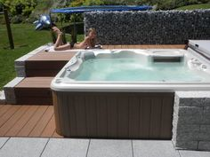 (disambiguation) Jacuzzi is a company producing whirlpool bathtubs and spas. The term 'jacuzzi' is often used generically to refer to any bathtub with underwater massage jets. Jacuzzi may also refer to: Outdoor Spa, Jacuzzi Outdoor, Whirlpool Deck, Sunken Hot Tub, Hot Tub Backyard, Natural Swimming Pools, Luxury Pools, Cold Shower, Shower Hose