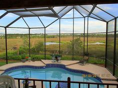 Heated salt water swimming pool! Fully screened enclosure! Summer kitchen with gas grill and refrigerator makes this a very enjoyable place to spend a summer evening! Barbecue with your friends! Watch the sunsets from this AMAZING view!!