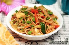 Learn how to make Hakka Noodles in 10 minutes with step by step photographs. Hakka Noodles are made from plain boiled noodles, stir fried with vegetables.