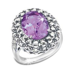 Empress Amethyst & Silver Ring | A gorgeous royal amethyst nestles within deep, ethereal marcasite stones on a sterling silver ring, harking back to the glamour of empresses and queens of old.