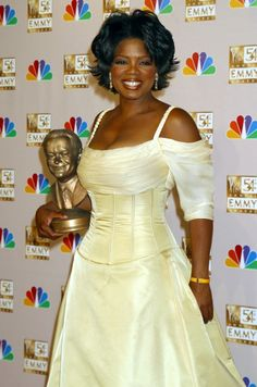 Oprah Whinfrey, Bob Hope Humanitarian Award recipient, in the press room at the 54h Annual Primetime Emmy Awards at the Shirne Auditorium in Los Angeles 09/22/02  Love love love Oprah's dress and love Bradley Bayou for making it!!