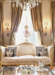 Love to see how the Fornasetti cushions are associated with a very classic french decor.