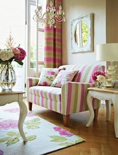 Room in soft greens and bold pinks.  Gorgeous Striped Sofa