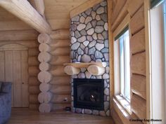 RIVER ROUND STONE FIREPLACE   Luxury Log Homes, Western Red Cedar Log Homes, Handcrafted Log Homes ...