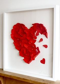 Blue background.  Red felt instead of tissue paper or torn old looking paper. On canvas not framed.