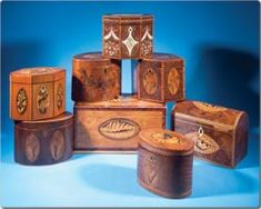 18th century English wooden tea caddies. The high cost of tea assured its status as a luxury item and necessitated a secure container for its storage and display. The construction and decoration of these containers was a reflection of the social rank of the owner. The finest furniture makers were enlisted to produce these boxes, each of which reflected the cabinetmaker's best work.