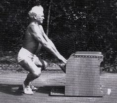 An archival image of Joseph #Pilates demonstrating the Arm Frog movement on the Wunda Chair.