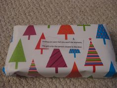 multiple layers of wrapping with instructions on what to do next taped to the new layer. gift exchange idea