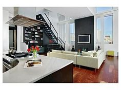 Open gourmet kitchen with granite counters, stainless appliances: Viking gas oven and Sub-Zero refrigerator.