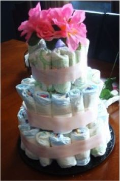 Take a peek at our darling baby diaper cakes. Take an additional 10% with coupon Pin60 at www.CreativeBabyBedding.com