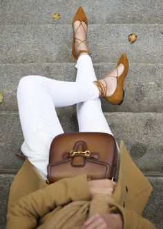 Camel Coat Contrasted With White Jeans