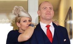 Zara Phillips and Mike Tindall share rare public moment of affection as they watch on at the Grand National at Aintree. (9 April 2016)