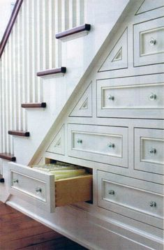 This overlooked part of the house has tons of pack-it-in potential. storage tips and organization tricks for small space living. under the stairs storage. how to maximize the space under stairs. Under Stairs Storage Drawers, Staircase Storage, Stair Storage, Stair Drawers, Basement Storage, Wall Storage, Eaves Storage, Staircase Ideas, Wooden Drawers