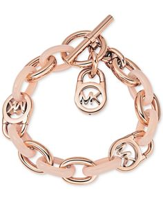 Get locked in to high fashion with Michael Kor's fulton bracelet, featuring chunky chain-links and a signature padlock motif. Crafted in rose gold-tone mixed metal and blush acetate. Toggle closure. A