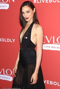 Hot metal! Gal's gown drew attention to her already-alluring bust with chunks of metal ado...