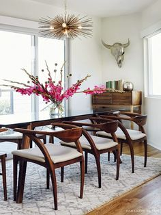 lusting over the burst pendant, faux metallic taxidermy + the stunning mod wooden seating