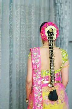South Indian bride. Gold Indian bridal jewelry.Temple jewelry. Jhumkis. Yellow and pink silk kanchipuram sari.braid with fresh jasmine flowers. Tamil bride. Telugu bride. Kannada bride. Hindu bride. Malayalee bride.Kerala bride.South Indian wedding.
