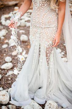 Bride wears a Mermaid Inspired Wedding Dress | Photography by http://www.gypsywestwood.com/