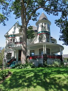 Home in Dubuque IA is very attractive architecturally - curved veranda, tower, and welcoming setting. Strange attempt at color should be carried much further; overall it's too white.