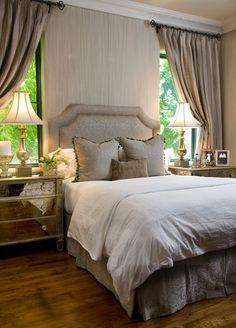 drapes, mirrored night stands & tall headboard