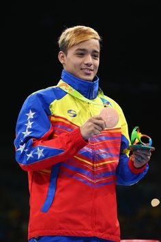 Bronze medalist Yoel Segundo Finol of Venezuela poses on the podium during the medal ceremony for the Men's Boxing Fly (52kg) on Day 16 of the Rio 2016 Olympic Games at Riocentro - Pavilion 6 on August 21, 2016 in Rio de Janeiro, Brazil.