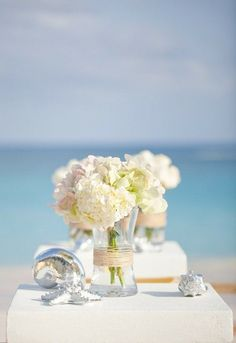 simple pale hydrangea with ribbon around the glass container