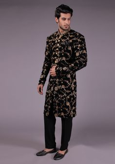 Product - Navy Product Overview: Crafted in Pakistan as a part of the winter this black sherwani features gold Amir Adnan signature embossed buttons. The outer garment is created using velvet fabric that makes t Wedding Kurta For Men, Wedding Dress Men, Wedding Suits, Wedding Wear, Trendy Mens Fashion, Indian Men Fashion, Suit Fashion, Male Fashion, Kids Fashion