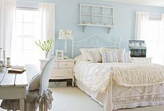 Serene blue master bedroom decorated with architectural salvage. Click for more photos from this Midwest home!