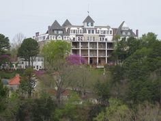 """Crescent Hotel, Eureka Springs, Arkansas ~ Built in 1886, the Crescent boasts luxury accommodations and the Ozark Mountains premier spa, all of which are appointed with the finest of Victorian antiques.  It's also ranked as one of the most haunted hotels in the U.S. - visitors may also take the Ghost Tour.  The SyFy show """"Ghost Hunters"""" made a visit there and caught a full body apparition on camera – a rare occurrence for the team.  #South #Southern"""