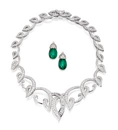14 KARAT WHITE GOLD AND DIAMOND NECKLACE, AND SIMULATED EMERALD AND DIAMOND DROPS. Designed as graduated scrollwork set with round and baguette diamonds weighing approximately 16.00 carats, length 15½ inches, together with two simulated emerald and diamond drops, the tops set with round diamonds weighing approximately 2.80 carats.