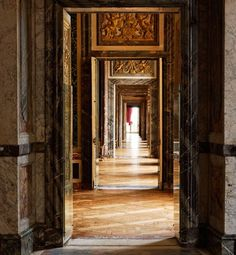 VERSAILLES - Several rooms whose doors line up to create a majestic sweep of interconnected spaces is called an enfilade; this one in the State Apartments is a stunning example.