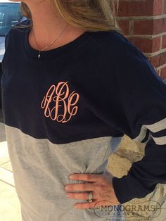 Our super popular spirit shirt is made even cuter with a giant monogram centered on the back or a 4 inch monogram on the front left chest! This listing is for a Navy/Heather Grey colored spirit shirt with one monogram. More colors available in our shop!  ***Please note that our spirit shirts do run big as all spirit shirts do, please order accordingly. The style of the shirt is to be roomy and comfy! : )  Master Circle font with coral thread shown in sample picture above.  Please include in…