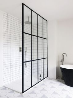 Steel-framed shower doors in a black-and-white-bath by Studio Maclean. Chris Tubbs photo