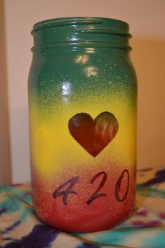 Quart sized hand painted 420 rasta jar Perfect for decor, flower vase, herb storage :) Lid comes in black or gold glitter