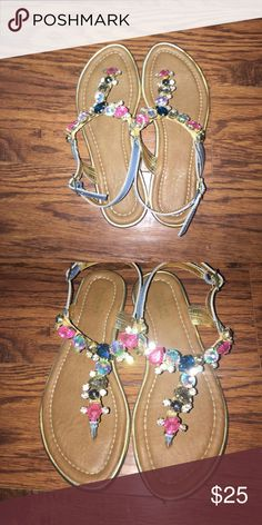 Carlos Santana (Teresa Gem Sandals) Size 6 and worn maybe twice 💕 no jewels missing or footprints to even clean 💕 outline is blue and gold bought the seat Macys 💕 Carlos Santana Shoes Sandals