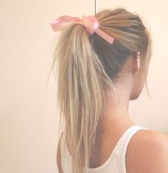 pretty pink bow dresses up a pony tail