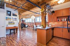 Feather Factory Lofts-2154 Dundas St W #107  | One-of-a-kind bright large authentic 1070 sf 2 bedroom SE corner loft with wrap around windows! | More info here: torontolofts.ca/feather-factory-lofts-lofts-for-sale/2154-dundas-st-w-107-1 Lofts, Feather, Corner, Bright, Windows, Bedroom, Kitchen, Table, Furniture