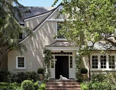 charming painted brick + copper top portico + climbing vine