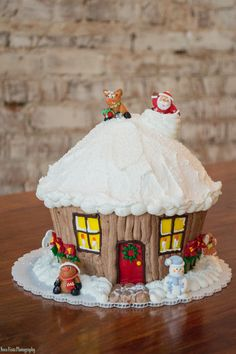 Christmas House (Giant Cupcake) : Marzipan decorations (Santa, snowman, & reindeer) were ordered from a company; Decorated by Tricia Gray at Honeymoon Bakery. Christmas Cake Decorations, Christmas Cupcakes, Christmas Sweets, Christmas Cooking, Holiday Cakes, Noel Christmas, Christmas Goodies, Christmas Houses, Xmas Cakes