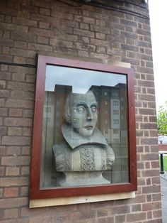 One of two Shakespeare busts in the doorway of the Shakespeare's Head pub.