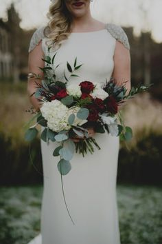Lovely Bridal Bouquet: White Hydrangea, White Roses, Deep Red Roses, Dark Blue Privet Berries, Burgundy Foliage, Green Silver Dollar Eucalyptus + Additional Greenery