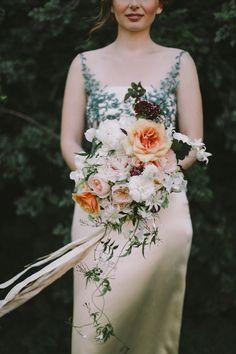 peach toned bouquet - photo by Lara Hotz http://ruffledblog.com/a-garden-greenhouse-wedding-in-australia