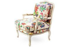 The colors on this arm chair make a statement in a chic library.