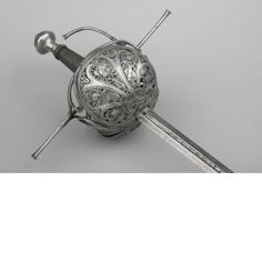 Italy c. 1630 - 1650 Iron or steel, chiselled Length: 130.1 cm Length: 109.8 cm, blade Width: 2.22 cm Weight: 1.25 kg