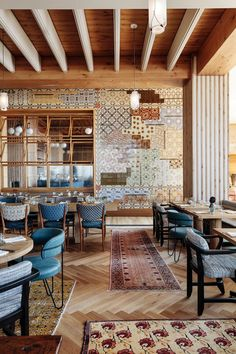 Kelly Wearstler Restaurants & Bars Design • Peacock • Peacock is reflective of the Mediterranean menu, inflused with elements that speak to Mediterranean culture and an authentic, intimate interior design that enriches the modern building layout. A mosaic tile wall of dead stock vintage tiles was sourced individually from a Portuguese family collection. Floral and geometric patterns are juxtaposed with mixed colors while patterned tiles and pencil tiles add an additional layer of texture.