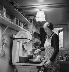 A wartime kitchen. This lady's name was Mrs Haslet and she lived in London. She was photographed cooking a meal on her gas cooker.