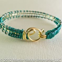 Guitar string bangle bracelet with green wire weave. Interesting Clasp