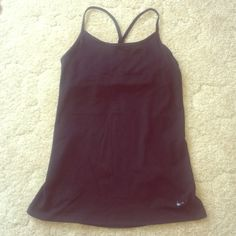 Nike Y Tank Black fitted Nike Y back tank. Has a built in bra but I lost the padding. Only worn a handful of times. I love it just never wear it! Nike Tops Tank Tops